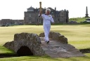 Torch bearer Louise Martin carries the London 2012 Olympic torch as she runs over the Swilken Bridge next to the eighteenth tee on the Old Course at St Andrews in Scotland