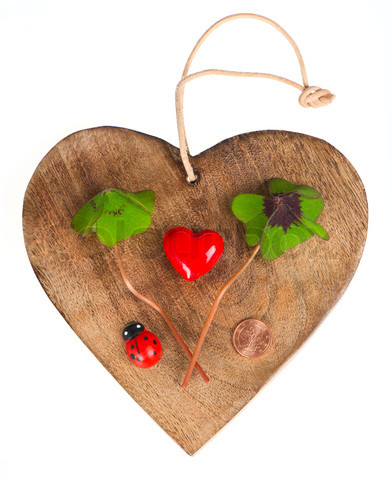 wooden heart with symbols of luck